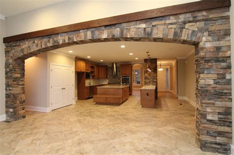 Open Concept Home Decorating Ideas interior stone archway between kitchen and great room