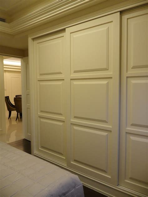 closet door sliding closet door bedroom with armchair bed skirt