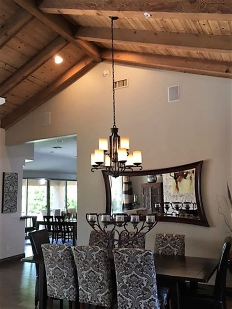 how to hang chandelier from ceiling hanging rectangular chandelier with 2 wires on sloped ceiling