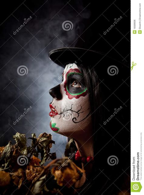 sugar skull woman in tophat holding dead roses royalty