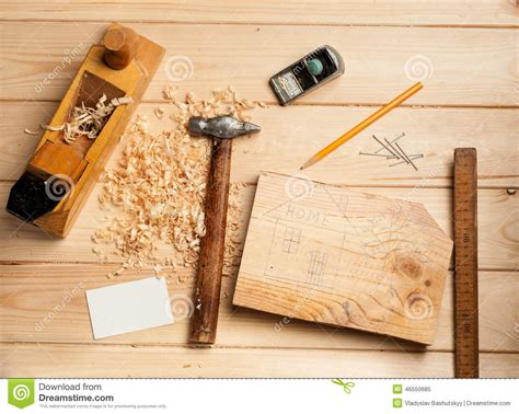 woodwork company joinery tools on wood table background with stock photo