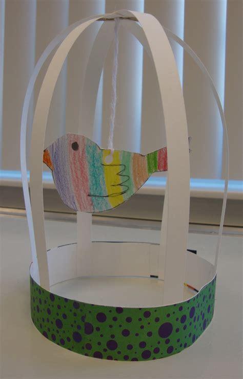 paper bird cage craft paper scissors glue bird cage sculptures