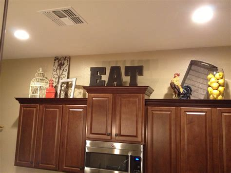ideas for top of kitchen cabinets 12 best ideas of top of kitchen cabinet decorating ideas