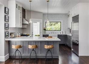 grey and white kitchen cabinets gray distressed kitchen cabinets with marble herringbone