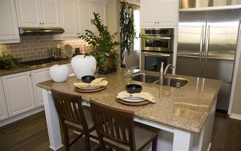 kitchen island with sink and seating hamilton arctic white thermofoil kitchen cabinets