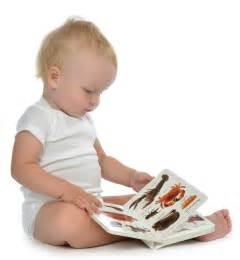 child reading book picture helping the whole child why ebc puts toys and books into