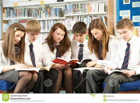 pictures of students reading books students in library reading books royalty free