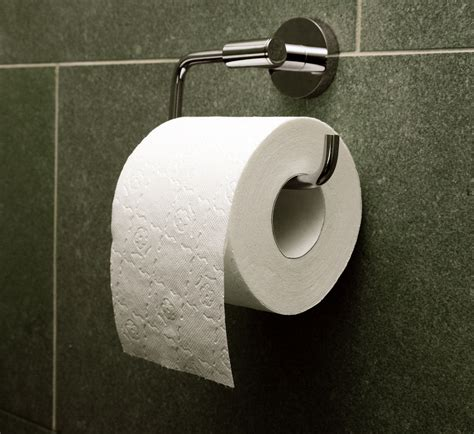 with toilet paper where should you install a toilet roll holder my
