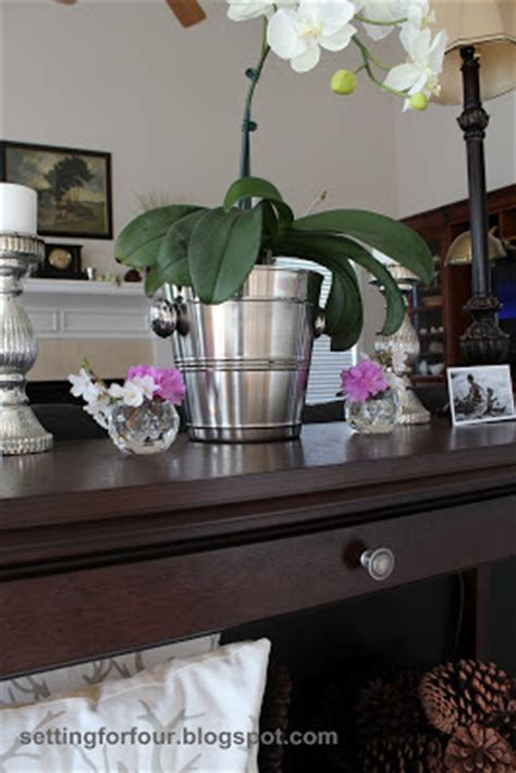 how to use a sofa table how to style a sofa table and define your living room