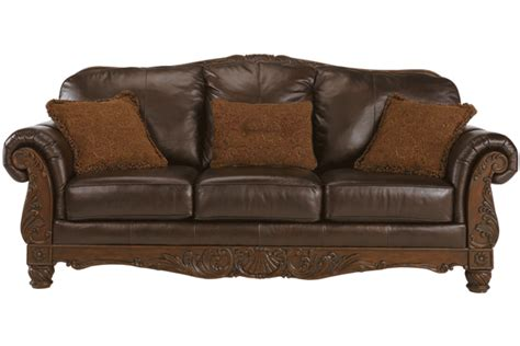 wood and leather sofas traditional leather sofa with show wood accent by