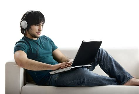 on computer boy on computer with headset digital learning