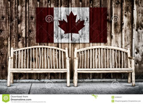 wooden canada rustic log benches with canada flag stock photo image