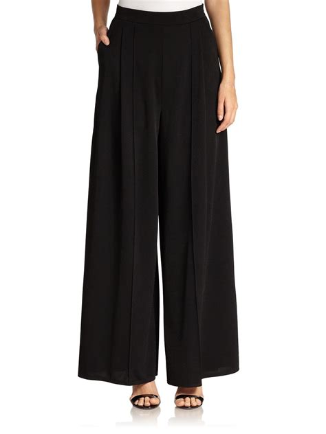 abs by allen schwartz pleated palazzo pants in black lyst