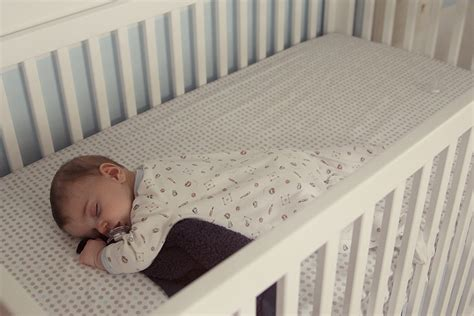 baby sleeps on side in crib baby to sleep in crib 4 ways to get a baby to sleep in a