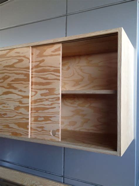 sliding cabinet doors and discreet handles keep the