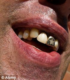 sheriff bans officers from having tattoos and gold teeth