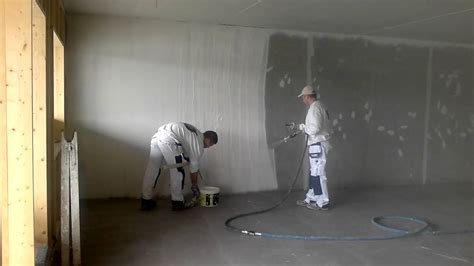 spray painting new plaster spray plastering concrete wall getting ready for painting