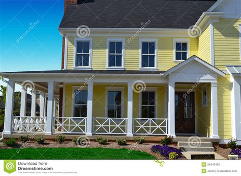 What Is A Cape Cod Style House yellow new england style home with porch stock image