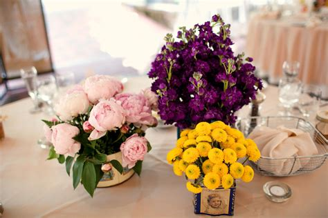 purple pink yellow wedding flower centerpieces onewed