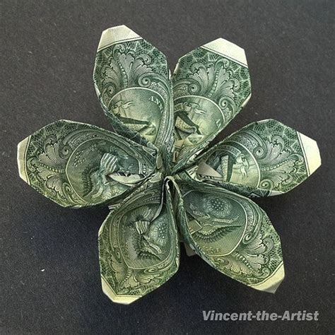 origami dollar flower dollar bill origami origami flowers and dollar bills on