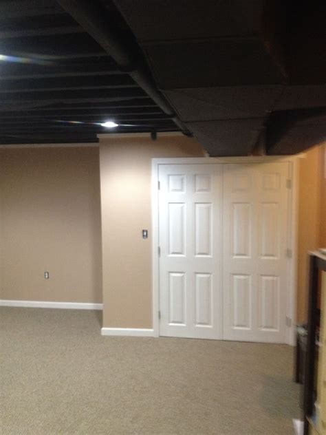 spray painting walls and ceilings this exposed basement ceiling was spray painted black due