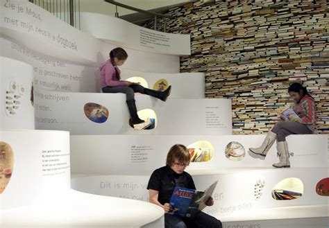 museum of picture book platvorm s papiria upcycled book wall encourages to