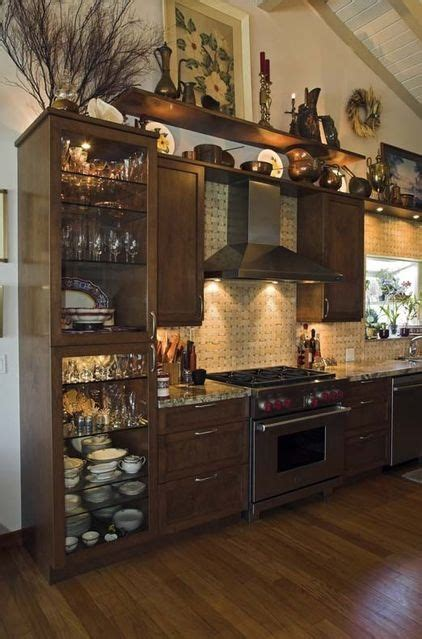 decorating above kitchen cabinets ideas how to decorate the top of a cabinet and how not to designed