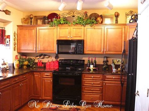 kitchen cabinet decorations pin by terrie krupitzer on decorating the top of kitchen