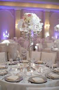 silver table decorations for wedding at the houstonian with photos by adam