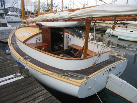 marine woodworking varnishing a wooden boat with organic linseed marine