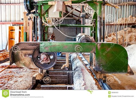 production woodworker industrial wood factory bandsaw sawmill stock image