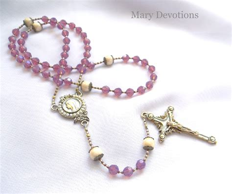 a rosary devotions blessed encircled in cyclamen opal