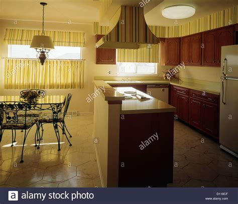 1970s kitchen cabinets 1970s kitchen and dining area with yellow striped curtains