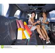 Women Drinking Wine In Limousine Royalty Free Stock Photos
