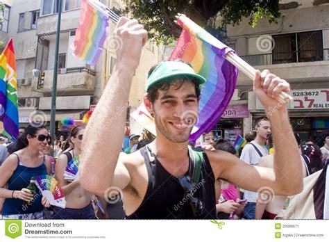 parade ta smiling youth with rainbow flag at pride parade ta
