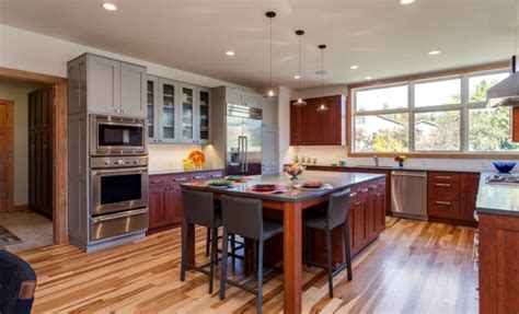 mixing kitchen cabinet colors trend alert mixed cabinet finishes in the kitchen