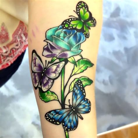 roses and butterflies tattoo idea