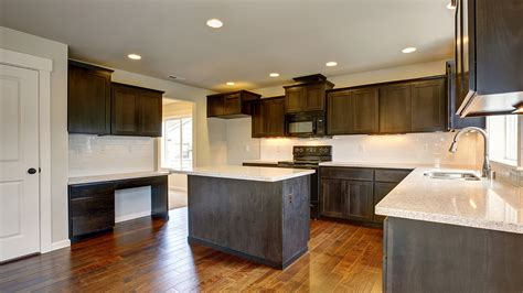 stain colors for kitchen cabinets should you stain or paint your kitchen cabinets for a