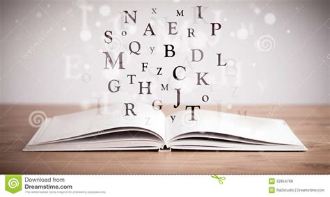 book with pictures opened book with flying letters stock photo image 32854768