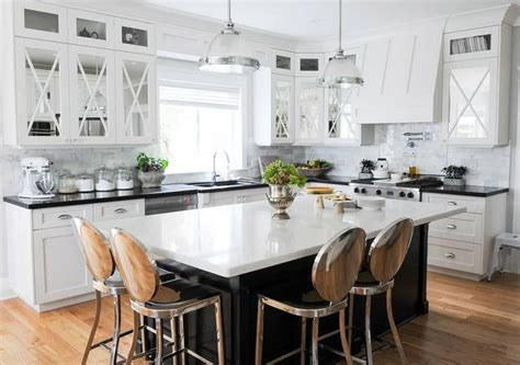 black kitchen island with philippe starck kong counter stools transitional kitchen
