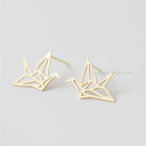 origami crane earrings origami crane earrings in gold blessing of the earrings