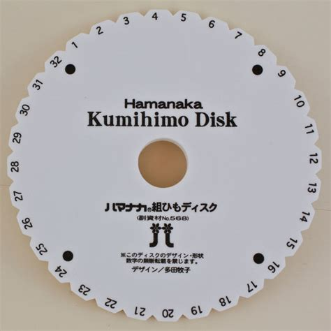 braiding with on the kumihimo disk braidershand kumihimo disk braiding and kumihimo