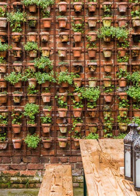 garden wall pots 21 simply beautitful diy vertical garden projects that