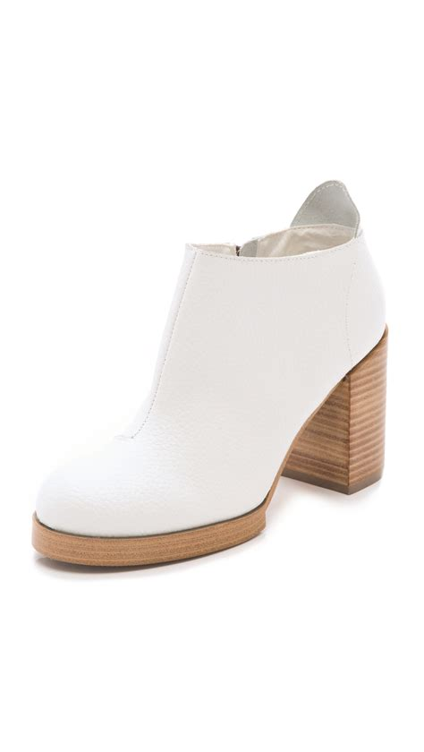 cheap chunky cheap monday layer chunky heel booties in white bone lyst