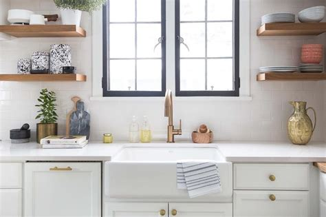 Kitchen Windows Over Sink by Brass Gooseneck Faucet And Farmhouse Sink Under Black