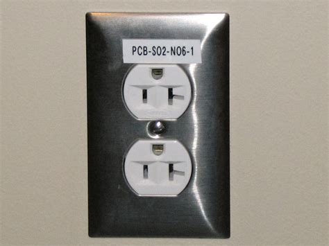 electrical outlet s file electrical outlet with label jpg wikimedia commons