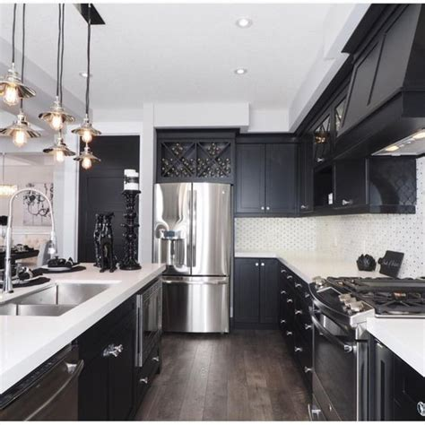 pictures of kitchens with white cabinets and black appliances why i m dreaming of a black kitchen organizing made