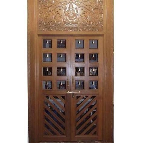 pooja room woodwork designs teak wood puja room door 500x500 jpg 500 215 500 pooja