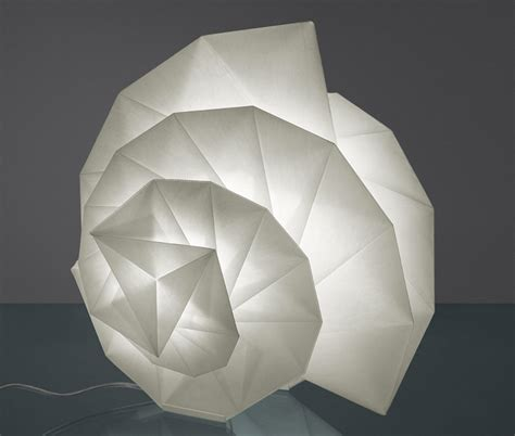 issey miyake origami artemide s new origami influenced lighting collection by