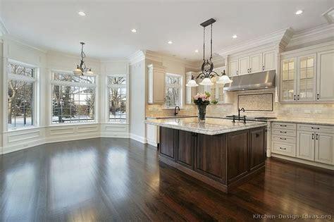 white kitchen wood island kitchen cabinets traditional two tone 212 s41064235x2 antique white wood island luxury jpg 800